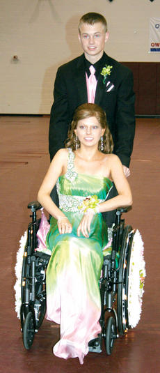 """<div class=""""source""""></div><div class=""""image-desc"""">Cooper Taylor and Rebekah Gaines were all smiles as they received a standing ovation from Saturday's grand march audience, the two would later be crowned prom prince and princess. </div><div class=""""buy-pic""""><a href=""""/photo_select/4825"""">Buy this photo</a></div>"""
