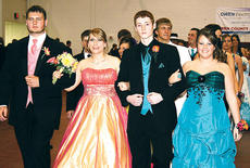 """<div class=""""source""""></div><div class=""""image-desc"""">Jonathan Caudill, Victoria House, Richard Swigert and Mattie Cooke made their way down the Owen County High School gymnasium floor Saturday during the school's annual Grand March, held each year before the prom.</div><div class=""""buy-pic""""><a href=""""/photo_select/4827"""">Buy this photo</a></div>"""