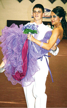 """<div class=""""source""""></div><div class=""""image-desc"""">Danielle Hoop got a little help from Collin Trammel as he carried her down the gymnasium floor during Saturday's event. Hoop would later be crowned prom queen; </div><div class=""""buy-pic""""><a href=""""/photo_select/4828"""">Buy this photo</a></div>"""