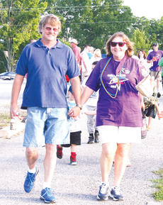 "<div class=""source""></div><div class=""image-desc"">Jim and Carolyn Meyers walk hand in hand during the survivor and caregiver lap. </div><div class=""buy-pic""><a href=""http://web2.lcni5.com/cgi-bin/c2newbuyphoto.cgi?pub=033&orig=Relay-11_0.jpg"" target=""_new"">Buy this photo</a></div>"