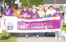 "<div class=""source""></div><div class=""image-desc"">Dozens of cancer survivors, friends, family and concerned volunteers turned out Friday for the annual Owen County Relay for Life at Itron Field.</div><div class=""buy-pic""><a href=""http://web2.lcni5.com/cgi-bin/c2newbuyphoto.cgi?pub=033&orig=Relay-2_0.jpg"" target=""_new"">Buy this photo</a></div>"