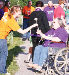 "<div class=""source""></div><div class=""image-desc"">American Cancer Society representative Jodi Dunavan hands out a flower to cancer survivor Therese Mitchell </div><div class=""buy-pic""><a href=""http://web2.lcni5.com/cgi-bin/c2newbuyphoto.cgi?pub=033&orig=Relay-6_1.jpg"" target=""_new"">Buy this photo</a></div>"