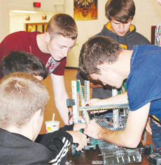 """<div class=""""source""""></div><div class=""""image-desc"""">Members of the Owen County team work on their robot during a recent competition. </div><div class=""""buy-pic""""><a href=""""/photo_select/8905"""">Buy this photo</a></div>"""