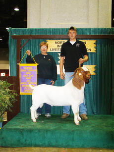 "<div class=""source""></div><div class=""image-desc"">Margie Turner, left,  of 2 Bit Boer Goat Ranch in Bartlett, Texas has entered a new partnership with Owen County's Sawyer Williams, over the future Winchester, an award-winning goat owned by Williams.</div><div class=""buy-pic""><a href=""http://web2.lcni5.com/cgi-bin/c2newbuyphoto.cgi?pub=033&orig=The%2BGoat.jpg"" target=""_new"">Buy this photo</a></div>"