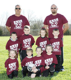 "<div class=""source""></div><div class=""image-desc"">U6 Team Smith: Pictured are (front row, left to right) Riley Coppola, Nash Boutwell, Gabrielle Perry, Amber Roberts; (second row, left to right) Tyler Brown, Davis Smith, Savannah Anderson, Austin Perkins. The coaches are Duane Smith and Matt Brown. </div><div class=""buy-pic""><a href=""http://web2.lcni5.com/cgi-bin/c2newbuyphoto.cgi?pub=033&orig=U6-Maroon.jpg"" target=""_new"">Buy this photo</a></div>"