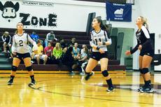 "<div class=""source""></div><div class=""image-desc"">Krissy Swigert, center, watches her return of serve during the Lady Rebels match with Henry County.</div><div class=""buy-pic""><a href=""http://web2.lcni5.com/cgi-bin/c2newbuyphoto.cgi?pub=033&orig=VB-DSC_0530.jpg"" target=""_new"">Buy this photo</a></div>"