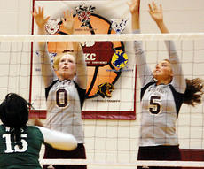 """<div class=""""source"""">Brian Blair</div><div class=""""image-desc"""">Owen County's Samantha Jacobs and Madison Gamble go for the block.</div><div class=""""buy-pic""""><a href=""""/photo_select/7892"""">Buy this photo</a></div>"""