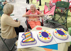 "<div class=""source""></div><div class=""image-desc"">Smith receives a special cake to mark her 100th birthday.</div><div class=""buy-pic""><a href=""/photo_select/9740"">Buy this photo</a></div>"