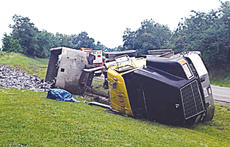 "<div class=""source"">Photo courtesy of Owenton Police Chief Terry Gentry</div><div class=""image-desc"">The driver of this overturned semi-truck was involved in another accident in downtown Owenton July 5.</div><div class=""buy-pic""><a href=""http://web2.lcni5.com/cgi-bin/c2newbuyphoto.cgi?pub=033&orig=Wreck-photo.jpg"" target=""_new"">Buy this photo</a></div>"