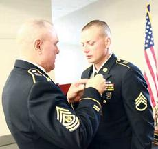 """<div class=""""source""""></div><div class=""""image-desc"""">Staff Sgt. Nicholas Anglin, right, a resident of Owenton, was recently recognized as  Kentucky Army National Guard's Noncommissioned Officer of the Year.</div><div class=""""buy-pic""""><a href=""""/photo_select/10932"""">Buy this photo</a></div>"""