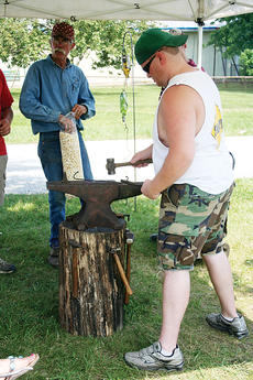 """<div class=""""source""""></div><div class=""""image-desc"""">Bottom: Brandon Dicapio tries his hand at blacksmithing while Steve Petzinger looks on.</div><div class=""""buy-pic""""><a href=""""/photo_select/2669"""">Buy this photo</a></div>"""