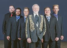 """<div class=""""source"""">Courtesy of www.doylelawson.com</div><div class=""""image-desc"""">Doyle Lawson began his professional Bluegrass career in 1963 when he joined Jimmy Martin and the Sunny Mountain Boys. He later played with J.D. Crowe before becoming a member of The Country Gentlemen. In 1979, Lawson formed Doyle Lawson and Quick Silver, one of the most highly-regarded Bluegrass acts today. </div><div class=""""buy-pic""""><a href=""""/photo_select/17737"""">Buy this photo</a></div>"""