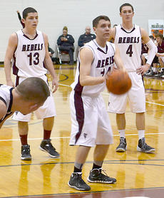 """<div class=""""source"""">Photo by Brian Blair</div><div class=""""image-desc"""">OCHS senior Trevor Lykins concentrates at the free-throw line against Williamstown Feb. 18 </div><div class=""""buy-pic""""><a href=""""/photo_select/11253"""">Buy this photo</a></div>"""