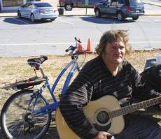 """<div class=""""source"""">John Whitlock</div><div class=""""image-desc"""">Doug Schwartzman has been riding his bike around the United States for the past few months. When his bike broke down in Owenton, local police lent a helping hand.</div><div class=""""buy-pic""""><a href=""""http://web2.lcni5.com/cgi-bin/c2newbuyphoto.cgi?pub=033&orig=bike.jpg"""" target=""""_new"""">Buy this photo</a></div>"""