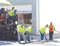 """<div class=""""source""""></div><div class=""""image-desc"""">Several streets throughout Owenton continue to be repaired and repaved. Above: Workers with Eaton Asphalt Paving Company blacktop a section of street at the corner of West Bryant and Cherry Street.</div><div class=""""buy-pic""""><a href=""""http://web2.lcni5.com/cgi-bin/c2newbuyphoto.cgi?pub=033&orig=blacktop-1.jpg"""" target=""""_new"""">Buy this photo</a></div>"""
