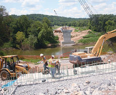 "<div class=""source"">John Whitlock</div><div class=""image-desc"">Workmen continue the long process of replacing the old bridge on KY 22. The new structure, which is approximately 500 feet upstream from the old bridge, is expected to be completed in December 2010.</div><div class=""buy-pic""><a href=""/photo_select/2240"">Buy this photo</a></div>"