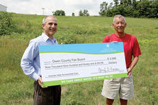 """<div class=""""source""""></div><div class=""""image-desc"""">Keith Cartier, left, vice president of operations for Kentucky American Water, presents a ceremonial check to Owen County Parks and Recreation Director Buck Beverly. The money will be used to fund """"Operation Clear, Preserve, and Reclaim.""""</div><div class=""""buy-pic""""><a href=""""/photo_select/12010"""">Buy this photo</a></div>"""