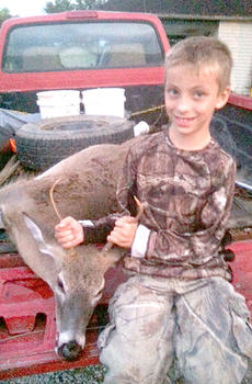 "<div class=""source"">Submitted</div><div class=""image-desc"">Gabe Carter of Sparta killed his first deer - a three-point buck. Gabe  Carter is the grandson of Jim Farrar.</div><div class=""buy-pic""><a href=""/photo_select/10627"">Buy this photo</a></div>"