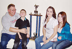 """<div class=""""source""""></div><div class=""""image-desc"""">Don Holleran, his son Donnie, wife Adella and daughter Shanna, pose for a picture with one of Donnie's trophies following a recent competition.</div><div class=""""buy-pic""""><a href=""""/photo_select/99"""">Buy this photo</a></div>"""
