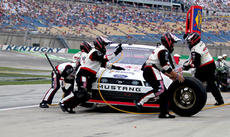 """<div class=""""source"""">Photo by Will Hearne</div><div class=""""image-desc"""">Brad Keselowski's pit crew display the skills that helped lead him to victory lane Saturday. </div><div class=""""buy-pic""""><a href=""""/photo_select/11938"""">Buy this photo</a></div>"""