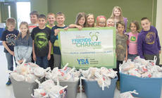 """<div class=""""source""""></div><div class=""""image-desc"""">Anna Riddle, center, and her classmates from the Friends For Change project filled 250 bags with food for the Backpack Program with help from a $500 grant from Disney Friends for Change program. </div><div class=""""buy-pic""""><a href=""""/photo_select/11539"""">Buy this photo</a></div>"""
