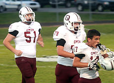 "<div class=""source""></div><div class=""image-desc"">Three Owen County players, including Sammy Chapman and Austin Klette, head off the field.  </div><div class=""buy-pic""><a href=""http://web2.lcni5.com/cgi-bin/c2newbuyphoto.cgi?pub=033&orig=football-3.jpg"" target=""_new"">Buy this photo</a></div>"