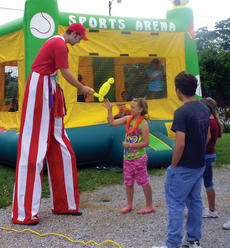 "<div class=""source"">John Whitlock</div><div class=""image-desc"">A balloon animal maker from the Cincinnati Circus Company offers gifts for people who attended Sunday's fundraiser for the Columbia family. </div><div class=""buy-pic""><a href=""http://web2.lcni5.com/cgi-bin/c2newbuyphoto.cgi?pub=033&orig=fund-1.jpg"" target=""_new"">Buy this photo</a></div>"