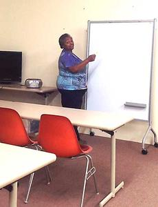 """<div class=""""source""""></div><div class=""""image-desc"""">Owen County Adult Education Director Veronica Gayle shows off one of the new classroom areas at the adult education center's new home. The center recently relocated to the former senior citizens center in downtown Owenton.</div><div class=""""buy-pic""""><a href=""""/photo_select/11049"""">Buy this photo</a></div>"""