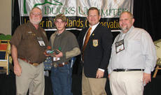"""<div class=""""source""""></div><div class=""""image-desc"""">Austin Riggs, second from left, was recently awarded the Greenwing of the Year from Ducks Unlimited. This is the first year the award has been presented. He received the honor for his dedication to the organization and his willingness to help other groups.</div><div class=""""buy-pic""""><a href=""""/photo_select/11621"""">Buy this photo</a></div>"""