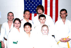 """<div class=""""source""""></div><div class=""""image-desc"""">The members of the Owen County Judo team shined during the 2011 Tennessee Open State Championships. Bringing home some of the honors were: (front row, left to right) Noah Malcolm, third place; Laura Lubbe, third place; (middle row) Chelsae Smith, second place; Earl Ritchie; Josh Ritchie, first place: (back row) John Thompson, second place; James Thompson, first place; and Robert Beverly, second place. </div><div class=""""buy-pic""""><a href=""""/photo_select/4612"""">Buy this photo</a></div>"""