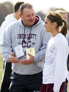 "<div class=""source""></div><div class=""image-desc"">Hoops talks strategy with her coach Jeff Sutton.</div><div class=""buy-pic""><a href=""/photo_select/960"">Buy this photo</a></div>"