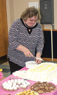 "<div class=""source"">Photos by John Whitlock</div><div class=""image-desc"">Kincaid cuts the cake at her retirement party. Kincaid worked in local government for over 35 years before resigning as country clerk in March.</div><div class=""buy-pic""><a href=""http://web2.lcni5.com/cgi-bin/c2newbuyphoto.cgi?pub=033&orig=joan-2.jpg"" target=""_new"">Buy this photo</a></div>"