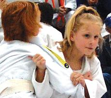 """<div class=""""source""""></div><div class=""""image-desc"""">Owen County judoko Emily True works against an opponent during Saturday's tournament held at Owen County High School.</div><div class=""""buy-pic""""><a href=""""/photo_select/1861"""">Buy this photo</a></div>"""