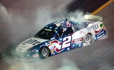 """<div class=""""source"""">Photo by Will Hearne</div><div class=""""image-desc"""">Penske Racing driver Brad Keselowski shows off for the crowd after his victory Saturday.</div><div class=""""buy-pic""""><a href=""""/photo_select/11943"""">Buy this photo</a></div>"""