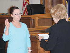 """<div class=""""source""""></div><div class=""""image-desc"""">Deputy Owen County Clerk Laurel Stivers, left, officially swears to Owen County Judge-executive Carolyn Keith that she has never fought a  duel as part of the oath of office as at the interim Owen County Clerk, Stivers will fulfill the term of Joan Kincaid. The incumbent clerk formally retired Tuesday morning.</div><div class=""""buy-pic""""><a href=""""http://web2.lcni5.com/cgi-bin/c2newbuyphoto.cgi?pub=033&orig=laurel-stivers-1.jpg"""" target=""""_new"""">Buy this photo</a></div>"""