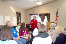 """<div class=""""source""""></div><div class=""""image-desc"""">Angie Woodward, center, discusses Owen County's history, strengths and how the group would like to see the county move forward at the retreat for this year's retreat for Leadership Owen County. </div><div class=""""buy-pic""""><a href=""""/photo_select/11291"""">Buy this photo</a></div>"""