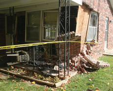 """<div class=""""source"""">Molly Haines</div><div class=""""image-desc"""">The front right corner of Norma Mae Poe's home was left in shambles after a police pursuit ended with Roy Austerman crashing into Poe's home early Thursday morning.</div><div class=""""buy-pic""""><a href=""""/photo_select/3036"""">Buy this photo</a></div>"""