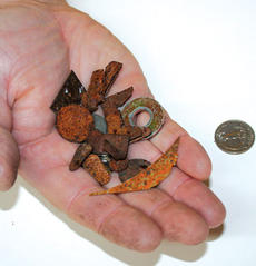 "<div class=""source"">unknown</div><div class=""image-desc"">Craig and Ann Shouse found these shards of sharp metal on their property along U.S. 127.</div><div class=""buy-pic""><a href=""http://web2.lcni5.com/cgi-bin/c2newbuyphoto.cgi?pub=033&orig=metal.jpg"" target=""_new"">Buy this photo</a></div>"