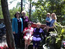 "<div class=""source""></div><div class=""image-desc"">Four generations, Mother's Day, 2001. This photo is not flattering of any of us, but it seems appropriate for today. I believe my mother - AND America McGinnis - would be proud of the strong women and mothers my three daughters have become. Certainly, I am. L-R, Shan, Georgia, Becky holding Eliza, Mother, & Georgeann holding Becky's son Jared. </div><div class=""buy-pic""></div>"
