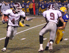 """<div class=""""source"""">Brian Blair</div><div class=""""image-desc"""">Owen County's Tyler Williams looks for a route during Friday's playoff game against Newport Catholic. The Rebels fell to the Breds, 50-14.</div><div class=""""buy-pic""""><a href=""""/photo_select/1029"""">Buy this photo</a></div>"""