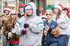 """<div class=""""source""""></div><div class=""""image-desc"""">The Owen County High School marching band made its way through the streets of Owenton, pepping up the parade with Christmas songs</div><div class=""""buy-pic""""><a href=""""/photo_select/1702"""">Buy this photo</a></div>"""