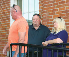 "<div class=""source""></div><div class=""image-desc"">Owen County candidate for sheriff and Owenton police officer Steve Miller, center, waits for primary results with his wife Patty Sue and Owenton Police Chief Terry Gentry.</div><div class=""buy-pic""><a href=""/photo_select/11798"">Buy this photo</a></div>"