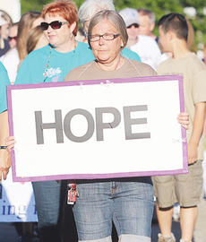 """<div class=""""source""""></div><div class=""""image-desc"""">Cathy Stamper holds up a sign of hope during Friday's team lap. </div><div class=""""buy-pic""""><a href=""""/photo_select/11831"""">Buy this photo</a></div>"""