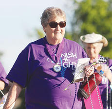 """<div class=""""source""""></div><div class=""""image-desc"""">Betty West smiles for the camera during the survivor lap.</div><div class=""""buy-pic""""><a href=""""/photo_select/11832"""">Buy this photo</a></div>"""