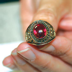 """<div class=""""source""""></div><div class=""""image-desc"""">This Owen County class ring was mailed to the school recently by staff members at an Ohio high school.</div><div class=""""buy-pic""""><a href=""""http://web2.lcni5.com/cgi-bin/c2newbuyphoto.cgi?pub=033&orig=ring.jpg"""" target=""""_new"""">Buy this photo</a></div>"""