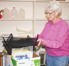 "<div class=""source"">Photo by Molly Haines</div><div class=""image-desc"">Dee Wedding packs up some of the office supplies to be moved to the new senior center. </div><div class=""buy-pic""><a href=""http://web2.lcni5.com/cgi-bin/c2newbuyphoto.cgi?pub=033&orig=sc-dee-wedding.jpg"" target=""_new"">Buy this photo</a></div>"
