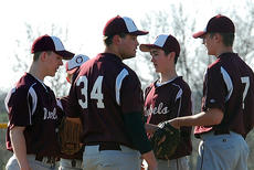 """<div class=""""source""""></div><div class=""""image-desc"""">The Owen County High School Rebels hold a meeting on the mound before the first pitch against Simon Kenton.</div><div class=""""buy-pic""""><a href=""""http://web2.lcni5.com/cgi-bin/c2newbuyphoto.cgi?pub=033&orig=springsports10-004.jpg"""" target=""""_new"""">Buy this photo</a></div>"""
