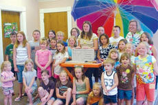 "<div class=""source""></div><div class=""image-desc"">Local children helped chisel out stepping stones for the library in conjunction with the summer reading program.</div><div class=""buy-pic""><a href=""/photo_select/1598"">Buy this photo</a></div>"