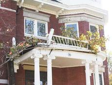 """<div class=""""source""""></div><div class=""""image-desc"""">A second-story balcony at the home of Richard Greene was damaged after Thursday night and Friday mornings storms.</div><div class=""""buy-pic""""><a href=""""/photo_select/10746"""">Buy this photo</a></div>"""