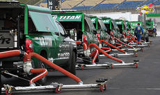 "<div class=""source"">Photo by Will Hearne</div><div class=""image-desc"">Dryers clean up some remnants of rain Saturday at the Quaker State 400 at the Kentucky Speedway.</div><div class=""buy-pic""><a href=""http://web2.lcni5.com/cgi-bin/c2newbuyphoto.cgi?pub=033&orig=track-dryers.jpg"" target=""_new"">Buy this photo</a></div>"